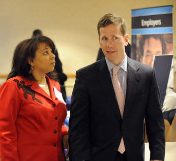 Representative Mayfield listens intently as Congressman Dold speaks at the Community Job and Resource Fair